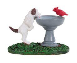 Bird bath dog fountain.